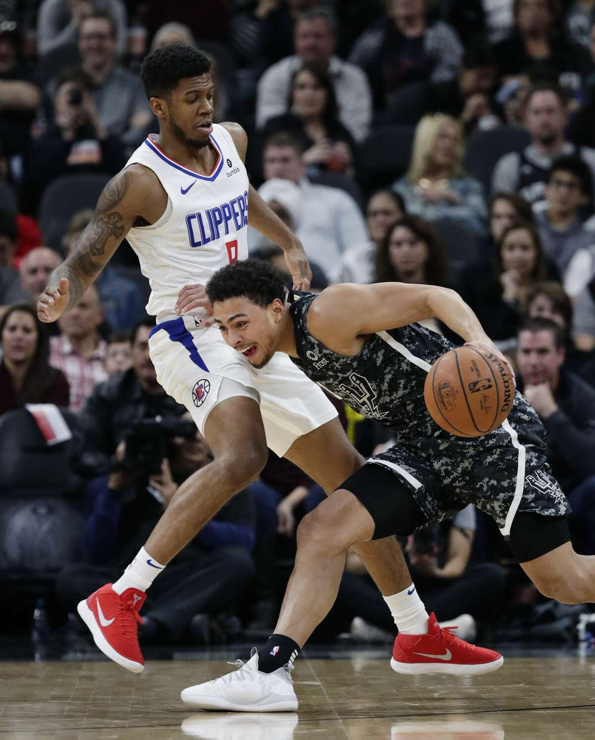 San Antonio Spurs guard Bryn Forbes (11) drives around Los Angeles Clippers guard Tyrone Wallace (9) during the first half of an NBA basketball game, Sunday, Jan. 20, 2019, in San Antonio. (AP Photo/Eric Gay)