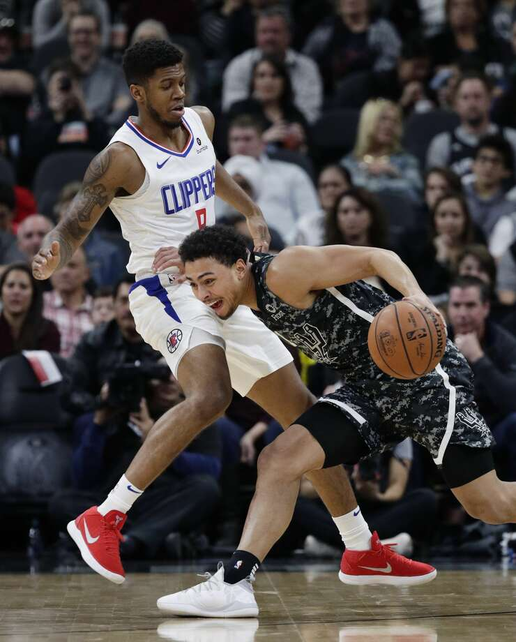 San Antonio Spurs guard Bryn Forbes (11) drives around Los Angeles Clippers guard Tyrone Wallace (9) during the first half of an NBA basketball game, Sunday, Jan. 20, 2019, in San Antonio. (AP Photo/Eric Gay) Photo: Eric Gay/Associated Press