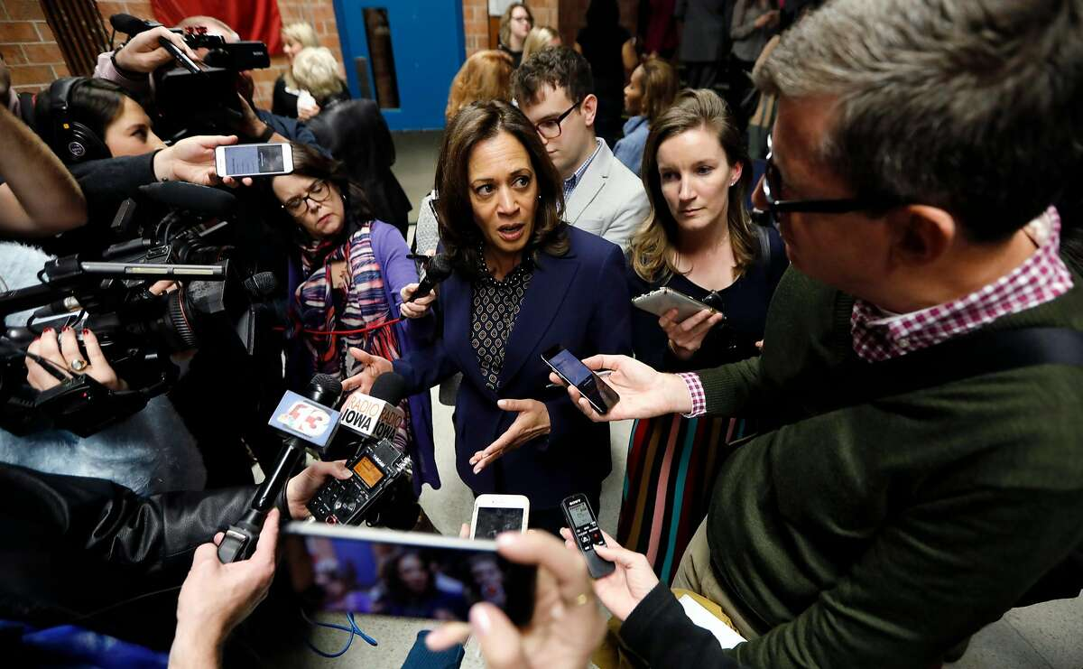 U.S. Sen. Kamala Harris, D-Calif., center, speaks to reporters following a get out the vote rally, Monday, Oct. 22, 2018, at Des Moines Area Community College in Ankeny, Iowa. (AP Photo/Charlie Neibergall)