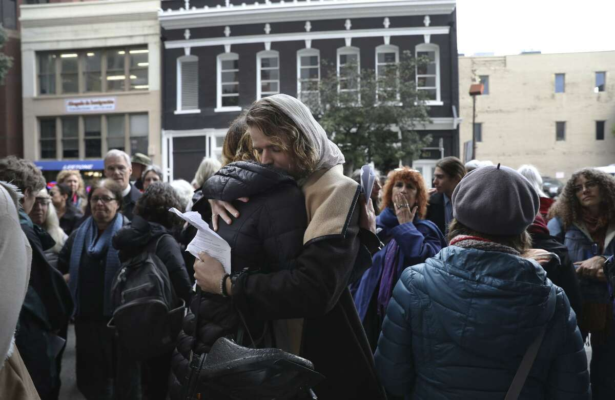 During a vigil at a government building protesting immigration policies and the border wall, Binya Kóatz (right) hugs a woman who gave testimony about her travel to the United States and the loss of a friend who died on the journey.