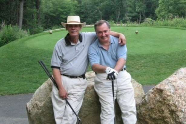 Former San Francisco Examiner editor Charles Cooper (left) is pictured with colleague Pete Wevurski during a round of golf in West Point, N.Y. Cooper died Saturday at age 76 from complications after heart surgery.