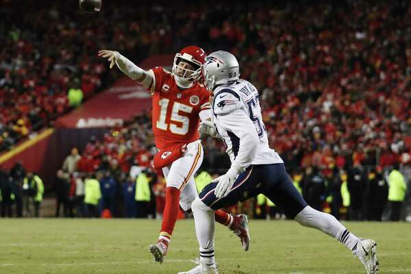 Kansas City Chiefs quarterback Patrick Mahomes (15) throws a touchdown pass to running back Damien Williams against New England Patriots middle linebacker Kyle Van Noy (53) during the second half of the AFC Championship NFL football game, Sunday, Jan. 20, 2019, in Kansas City, Mo.
