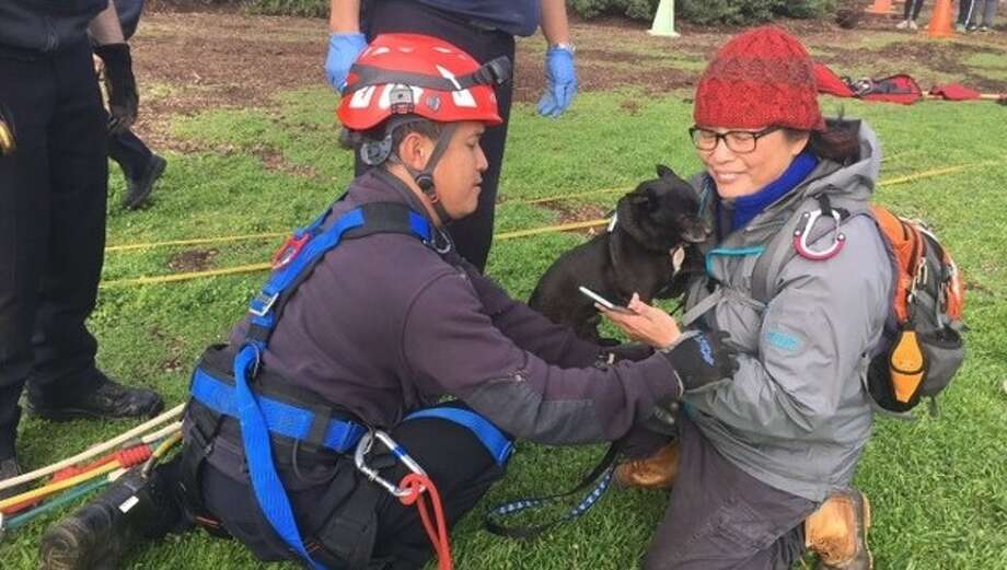 Duck the dog spent the night on the cliffs but was spotted Sunday morning by people hang gliding nearby. Photo: SF Fire Department