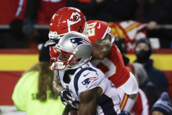 New England Patriots wide receiver Phillip Dorsett (13) makes a touchdown reception against Kansas City Chiefs cornerback Steven Nelson (20) during the first half of the AFC Championship NFL football game, Sunday, Jan. 20, 2019, in Kansas City, Mo.
