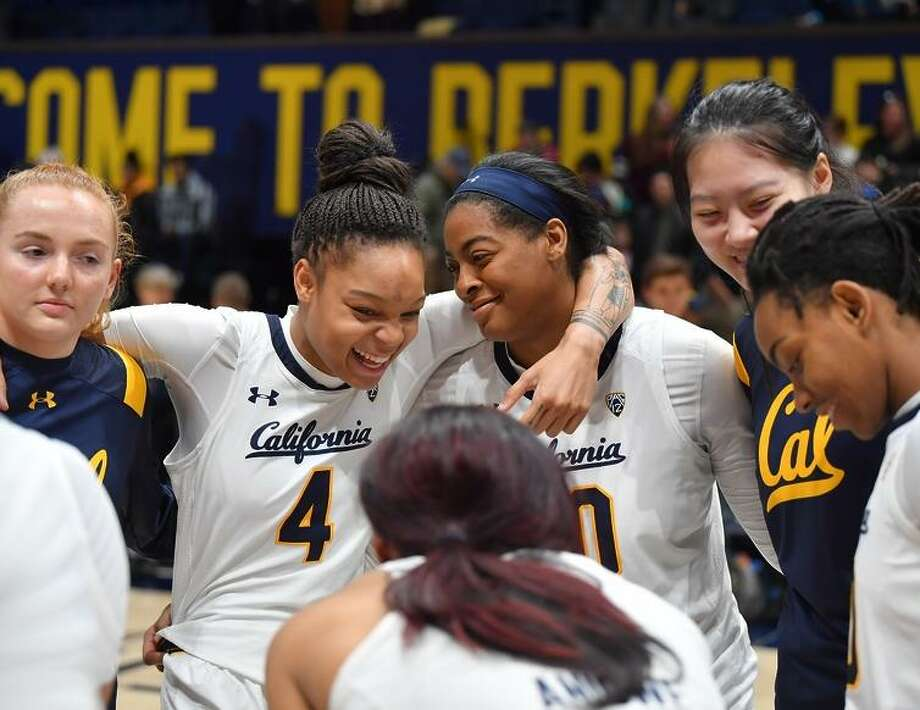 Cal players talk during a timeout during a Women's basketball game between University California and Washington at Haas Pavilion at UC Berkley on Sunday, January 20, 2019. Photo: Rob Edwards / KLC Fotos
