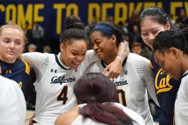 Cal players talk during a timeout during a Women's basketball game between University California and Washington at Haas Pavilion at UC Berkley on Sunday, January 20, 2019.