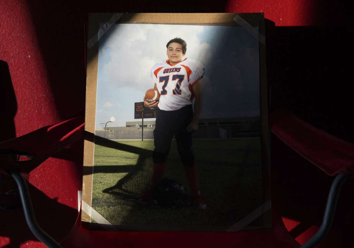 An enlarged Gabriel Fernandez's photograph is set on a chair at his house on Sunday, Jan. 20, 2019, in Houston. Gabriel, 13, was accidentally shot by his friend while they were hanging out and died Saturday.