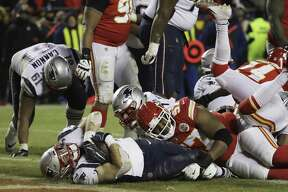 New England Patriots running back Rex Burkhead (34) dives to the end zone for a touchdown to win the AFC Championship NFL football game against the Kansas City Chiefs in overtime, Sunday, Jan. 20, 2019, in Kansas City, Mo.