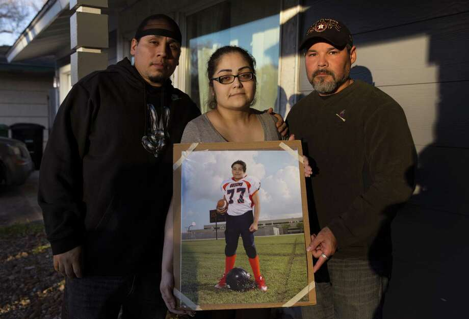 Gabriel Fernandez's stepfather, Daniel Gonzalez, from left, mother, Jennifer Valdez, and father, Orlando Fernandez, pose with a photograph of Gabriel Fernandez at his house on Sunday, Jan. 20, 2019, in Pasadena. Photo: Yi-Chin Lee,  Houston Chronicle / Staff Photographer / © 2019 Houston Chronicle