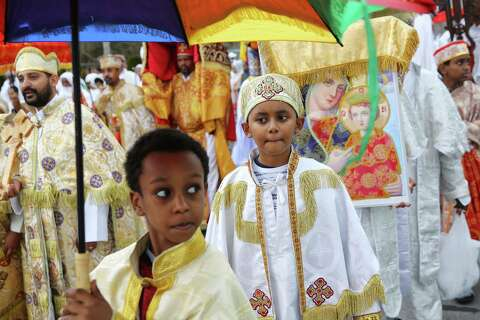 6085bbd9757 Hundreds walk in a procession from King s Hall to St. Michael Ethiopian  Orthodox Church during
