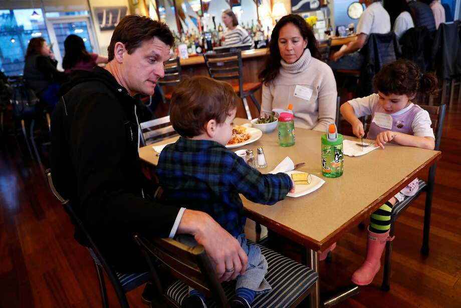 Coast Guard member James Weigand with his son Parker, 2; wife, Krysia; and daughter, Sienna, 4, at the South Beach Yacht Club spaghetti dinner. Photo: Scott Strazzante / The Chronicle