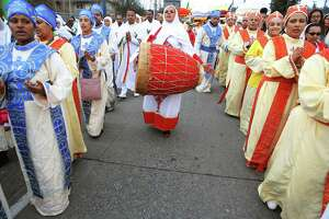 Hundreds walk in a procession from King's Hall to St. Michael Ethiopian Orthodox Church during a celebration of Timkat, the Ethiopian Orthodox Tewahedo Church's Epiphany, Sunday, Jan. 20, 2019.