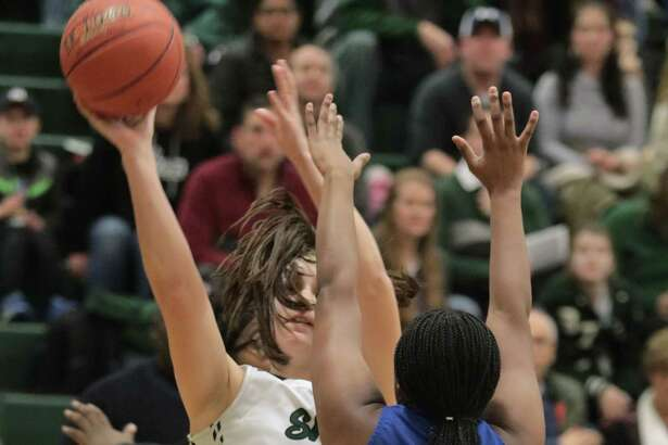 Shenendehowa's Meghan Huerter goes to the basket over Albany defender Hasijna Gaddy during the girls' basketball matchup at Shenendehowa High School Friday, January 18, 2019. (Ed Burke photo-Special to the Times Union)