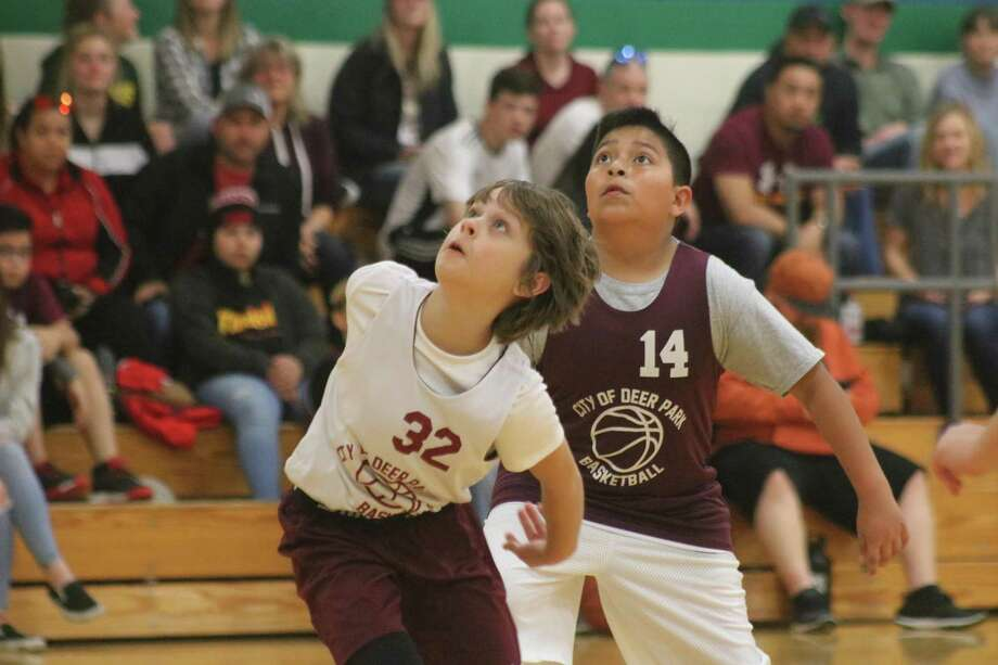 Warriors player Andy Warrick (32) watches the outcome of a free-throw attempt by a teammate during Saturday's season openers for the 10U division at Fairmont Junior High. Offensively, Warrick had a big hand in helping the team score 25 points. Photo: Robert Avery