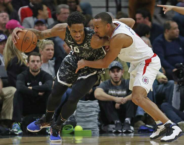 DeMar DeRozan #10 of the San Antonio Spurs is guarded by Avery Bradley #11 of the Los Angeles Clippers on Sunday, January 20, 2019 at AT&T Center.