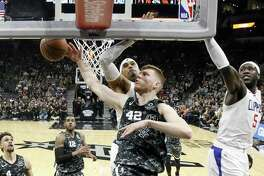 Davis Bertans #42 of the San Antonio Spurs shoots over Clippers on Sunday, January 20, 2019 at AT&T Center.