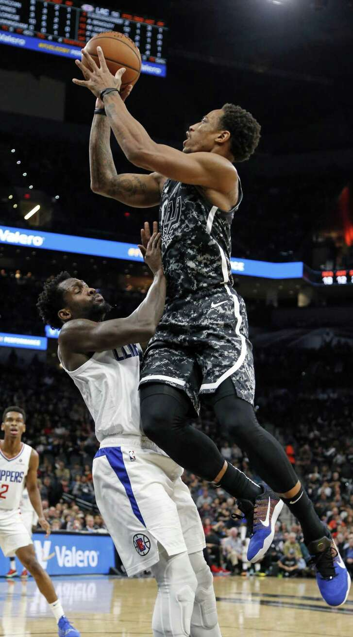 DeMar DeRozan #10 of the San Antonio Spurs shoots over Patrick Beverley #21 of the Los Angeles Clippers on Sunday, January 20, 2019 at AT&T Center.