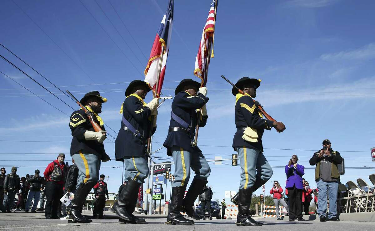 The Buffalo Soldiers Color Guard posts the colors at the start of the Martin Luther King Jr. wreath-laying ceremony at MLK Plaza at East Houston Street and North New Braunfels Avenue.