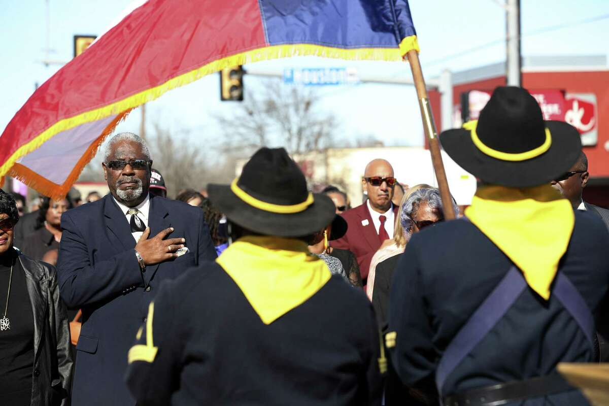 Nathaniel Davis, left, chair of the Rev. Martin Luther King Jr. Commission and March Program, salutes during the posting of the colors by the Buffalo Soldiers during a wreath-laying ceremony on Jan. 20, 2019. The ceremony was held at MLK Plaza, at East Houston Street and North New Braunfels Avenue.
