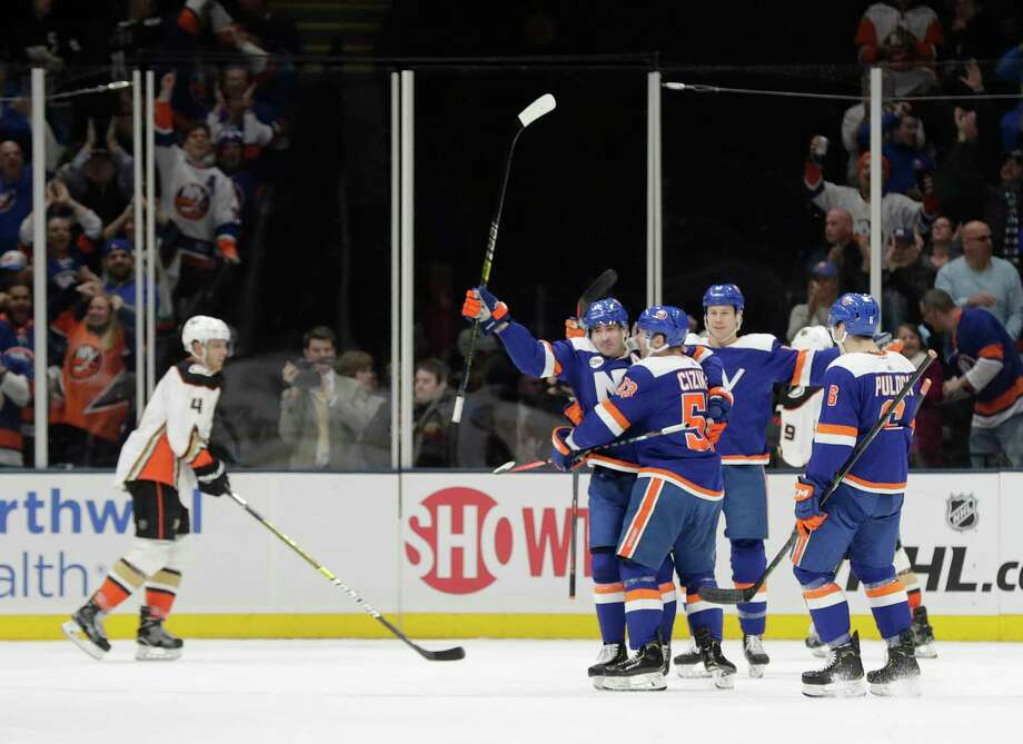 New York Islanders' Cal Clutterbuck, second from left, celebrates with teammates after scoring a goal as Anaheim Ducks' Cam Fowler (4) skates past during the first period of an NHL hockey game Sunday, Jan. 20, 2019, in Uniondale, N.Y. (AP Photo/Frank Franklin II) Photo: Frank Franklin II / Copyright 2019 The Associated Press. All rights reserved