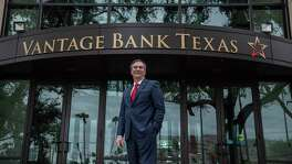 Sam Munafo, who has been CEO and president of Inter National Bank of McAllen, now leads San Antonio-based Vantage Bank Texas after the two banks merged in November. He is pictured outside his office in McAllen.