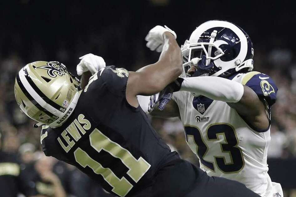 Rams defensive back Nickell Robey-Coleman (23) went unflagged on this play, to the dismay of wide receiver Tommylee Lewis (11) and the Saints, who lost the chance to milk the rest of the clock before kicking a go-ahead field goal. Los Angeles had time to march to a tying field goal before getting another in overtime to win Sunday's NFC Championship Game.