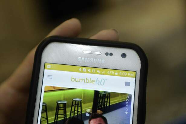 Candace Gooding demonstrates how she uses Bumble BFF on her cell phone during a meeting of their bookclub Wednesday, June 22, 2016, in Houston. The friends met through Bumble BFF, a service for finding platonic friendships within the dating app Bumble. ( Mark Mulligan / Houston Chronicle )