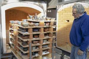 Chris Stanley an associated professor of art in ceramics at the University of Texas of the Permian Basin opens the kiln to reveal bowls made for the West Texas Food Bank's Empty Bowl Event on Thursday, Jan. 17, 2019 at the Charles A. Sorber Visual Arts Studios.  Jacy Lewis/191 News