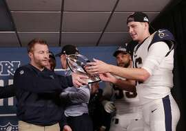 Los Angeles Rams head coach Sean McVay and Los Angeles Rams quarterback Jared Goff hold the NFC Championship trophy after overtime of the NFL football NFC championship game against the New Orleans Saints, Sunday, Jan. 20, 2019, in New Orleans. The Rams won 26-23. (AP Photo/David J. Phillip)
