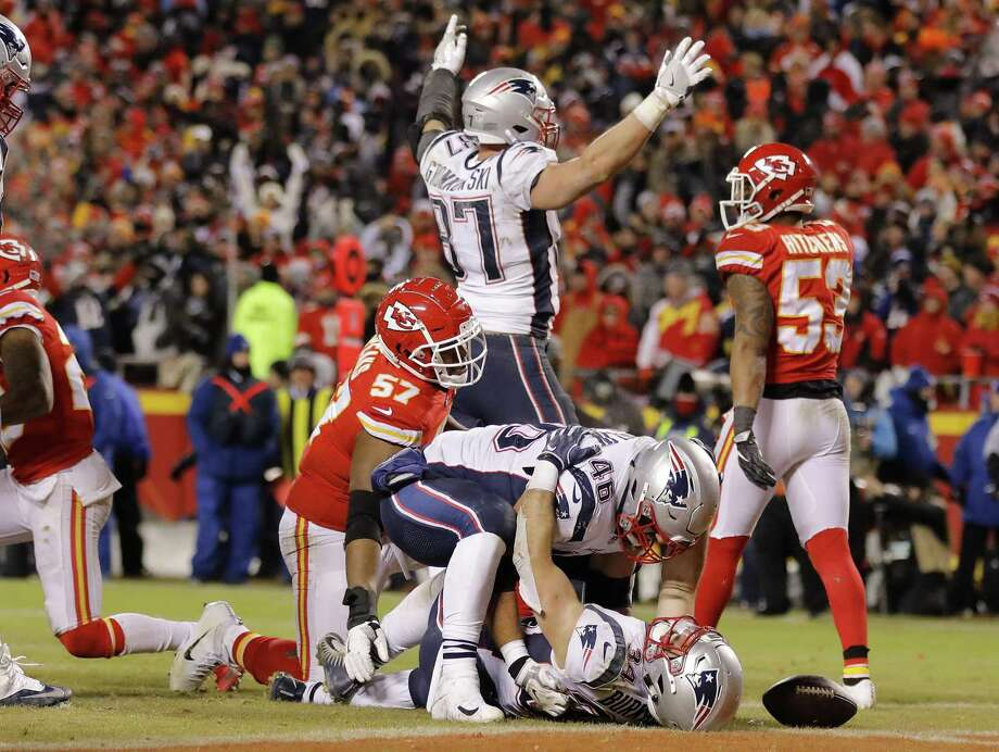 KANSAS CITY, MISSOURI - JANUARY 20: Rex Burkhead #34 of the New England Patriots celebrates with James Develin #46 after scoring the game-winning touchdown to defeat the Kansas City Chiefs in overtime during the AFC Championship Game at Arrowhead Stadium on January 20, 2019 in Kansas City, Missouri. The Patriots defeated the Chiefs 37-31. (Photo by David Eulitt/Getty Images) Photo: David Eulitt / Getty Images / 2019 Getty Images
