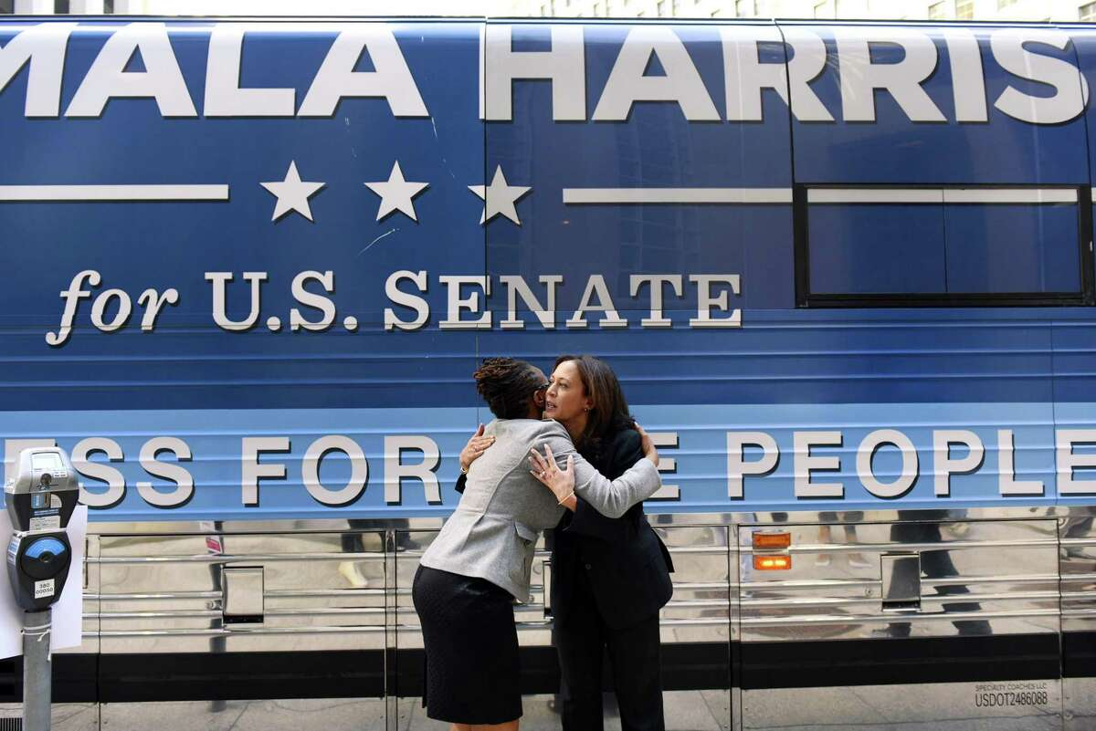 Then-California Attorney General Kamala Harris (right), during her candidacy for U.S. Senate, hugs BART board candidate Lateefah Simon in November 2016.