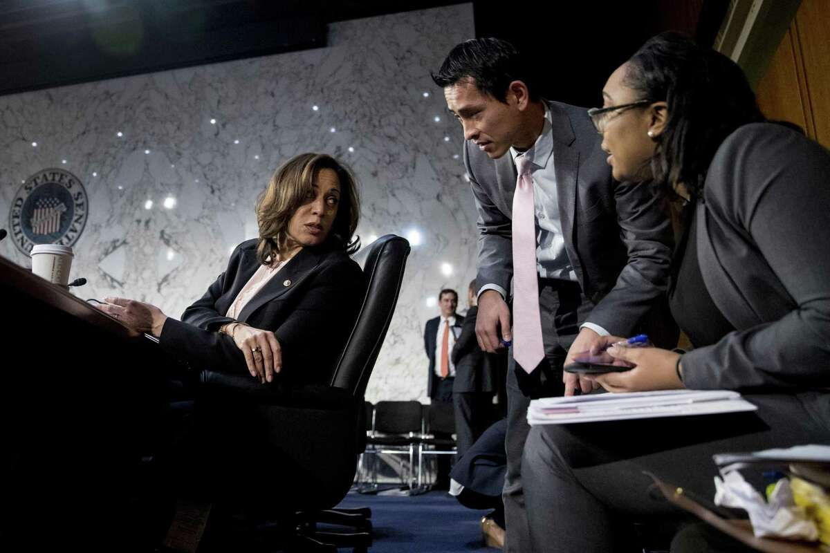Sen. Kamala Harris, D-Calif. (left), speaks with aides during a break from testimony from Attorney General nominee William Barr at a Senate Judiciary Committee hearing on Capitol Hill in Washington Jan. 15.