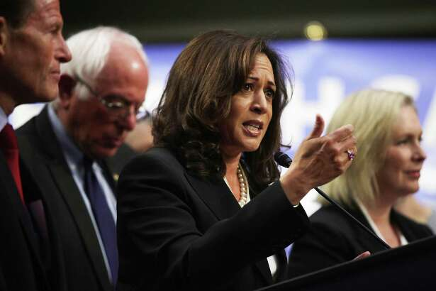 WASHINGTON, DC - SEPTEMBER 13: U.S. Sen. Kamala Harris (D-CA) (C) speaks on health care as Sen. Bernie Sanders (I-VT) (2nd L) listens during an event September 13, 2017 on Capitol Hill in Washington, DC. Sen. Sanders held an event to introduce the Medicare for All Act of 2017. (Photo by Alex Wong/Getty Images)