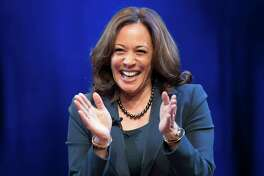 In this Jan. 9, 2019 photo, Sen. Kamala Harris, D-Calif., greets the audience at George Washington University in Washington, during an event kicking off her book tour. Harris, a first-term senator and former California attorney general known for her rigorous questioning of President Donald Trump's nominees, entered the Democratic presidential race on Monday.