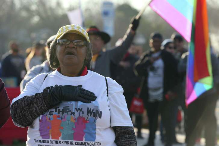 Paulette Burns, 67, joins in a service at ML King Academy, before the Martin Luther King, Jr. March, Monday, January, 21, 2019.