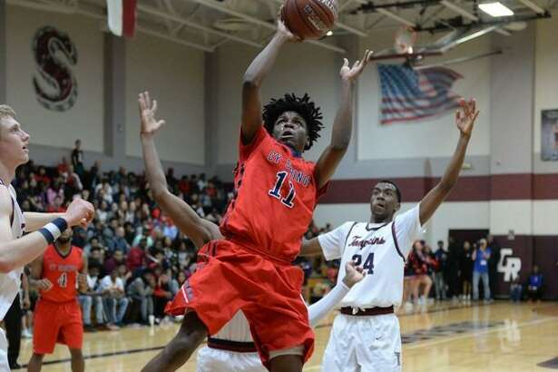 Cameron Scott (11) of Cy Springs drives the lane for a shot during last season?'s playoffs.