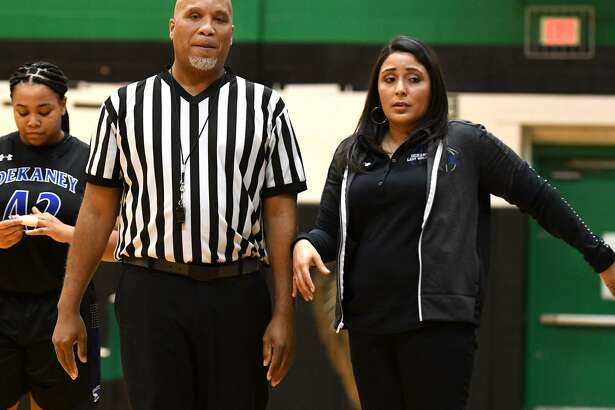 Dekaney Head Girls Basketball Coach Larissa Leal-Thomas, right, leads her team against Spring during their District 16-6A matchup at Spring High School on Jan. 4, 2019.
