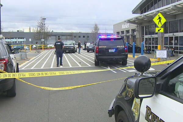 Police investigate after a 16-year-old was shot in the chest at a Renton Walmart.