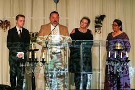 Kevin, Cindy, and Noah Vest, as well as CASA Advocate Rina French, share their success story with CASA during the CASA Speaks for Kids Annual Gala on Saturday, Feb. 10, 2018, at The Woodlands Waterway Marriott Hotel.