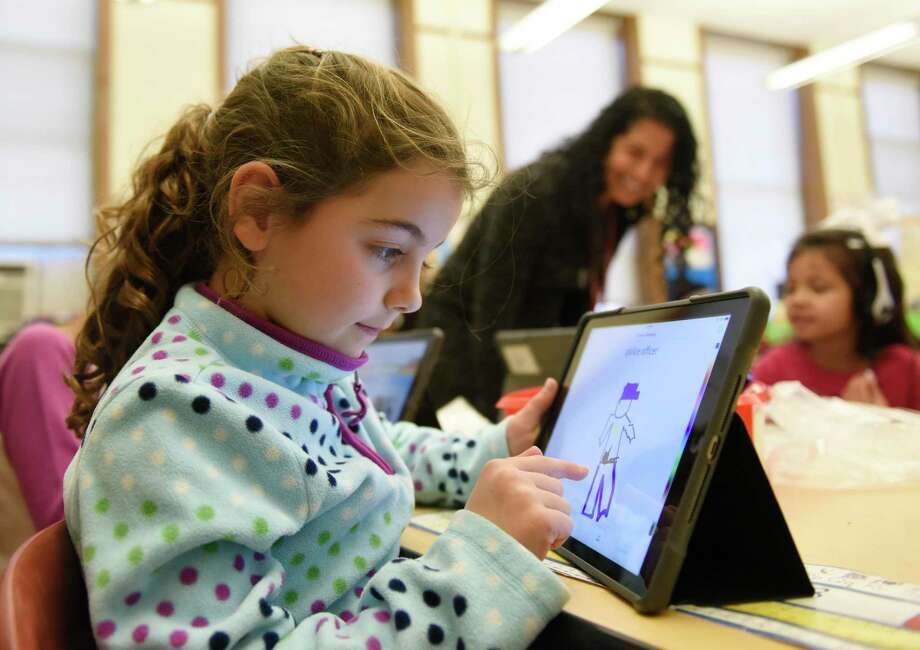Second-grader Clara Cahill draws using the Seesaw app during class at Julian Curtiss School in Greenwich, Conn. Monday, Jan. 7, 2019. The Seesaw app lets students take photos, draw, and record videos of what they're learning in school and allows parents to see their work, monitor progress and send encouragement digitally. Photo: Tyler Sizemore / Hearst Connecticut Media / Greenwich Time