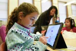 Second-grader Clara Cahill draws using the Seesaw app during class at Julian Curtiss School in Greenwich on Monday, Jan. 7. The Seesaw app lets students take photos, draw, and record videos of what they're learning in school and allows parents to see their work, monitor progress and send encouragement digitally.