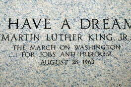 """An engraving at the Lincoln Memorial marks the spot where Martin Luther King Jr. made his 1963 """"I Have a Dream"""" speech August 22, 2003, in Washington, D.C. Photo by Mark Wilson/Getty Images"""