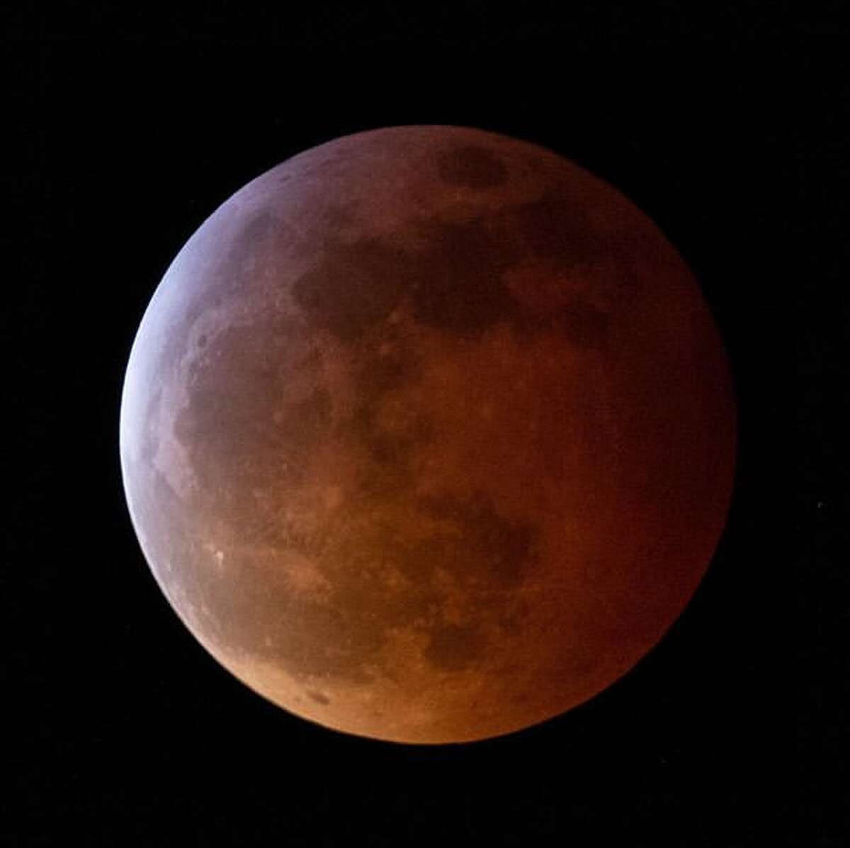 The clouds parted so @telephototim could photograph the Super Blood Wolf Moon Lunar Eclipse on Sunday, January 20, 2019.