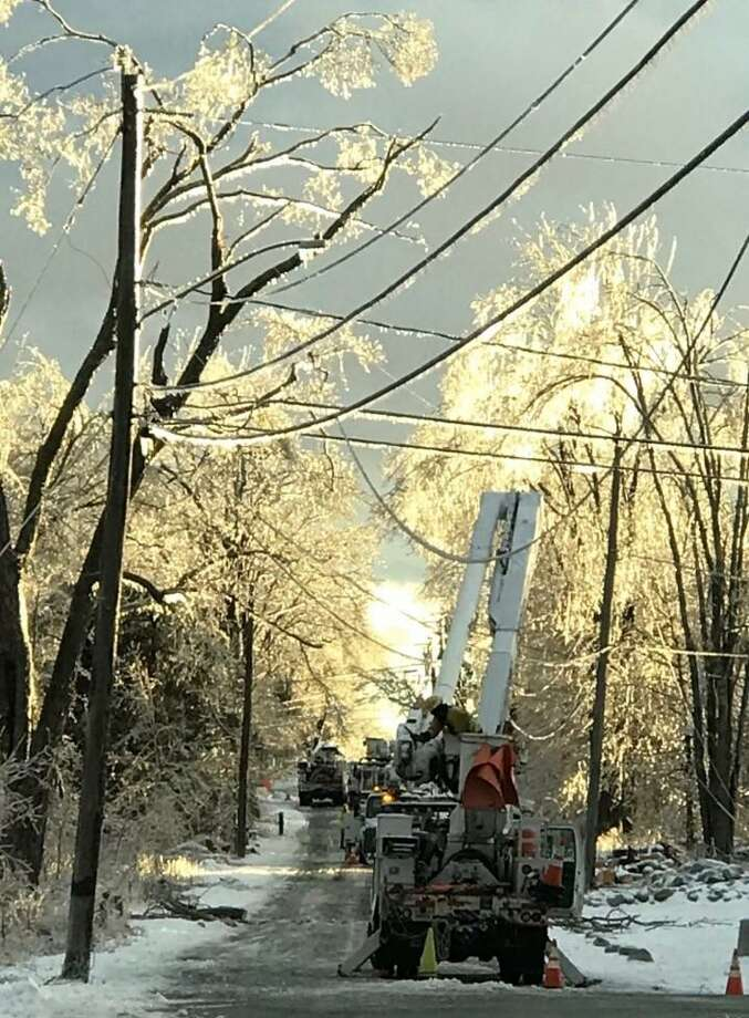 Eversource workers restore utility service to residents of Pope Hill Road in Bethany. Photo: Contributed Photo