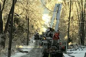 Eversource workers restore utility service to residents of Pope Hill Road in Bethany.