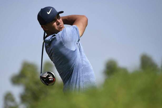 Brooks Koepka of the United States tees off at the third hole in round two of the Abu Dhabi Championship golf tournament in Abu Dhabi, United Arab Emirates, Thursday, Jan. 17, 2019. (AP/Martin Dokoupil)