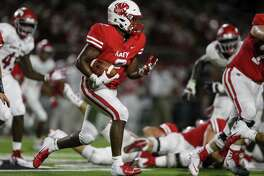 Katy's Deondrick Glass (2) carries the ball during an August 2018 high school football game between the North Shore Mustangs and the Katy Tigers at Legacy Stadium in Houston.