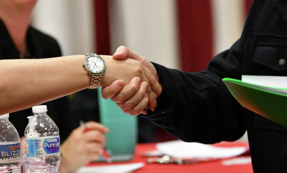 Job seekers talk with recruiters during a Times Union Job Fair at the Albany Marriott hotel on Monday, Jan. 21, 2019 in Colonie, N.Y. (Lori Van Buren/Times Union)