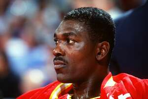 1993:  A CANDID PORTRAIT OF HOUSTON ROCKETS CENTER HAKEEM OLAJUWON ON THE BENCH BEFORE A GAME AGAINST THE NUGGETS. Mandatory Credit: Tim Defrisco/ALLSPORT