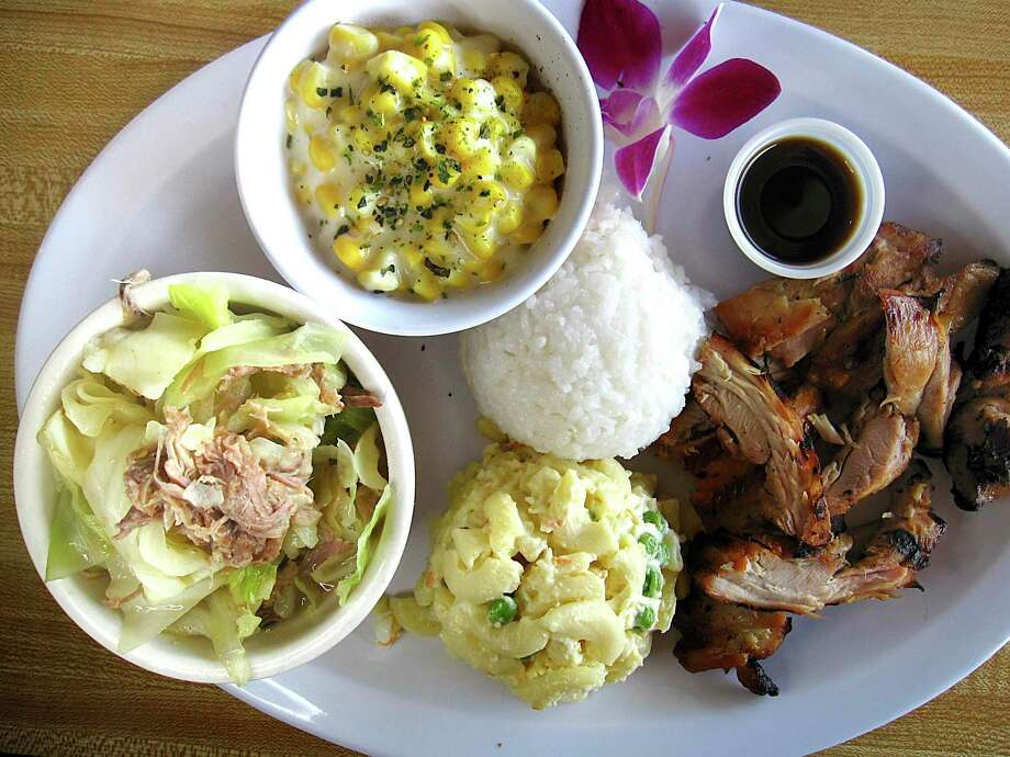Combination plate lunch including (clockwise from bottom left) kalua pork with cabbage, creamed corn, rice, huli huli chicken and mac-and-potato salad from Aloha Kitchen. Photo: Mike Sutter /Staff